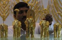 Gold hits 7-week high, silver shines as dollar slides