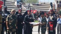 Pakistani Rangers offer sweets to BST at Attari Wagah Border on Pakistan National Day