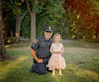Texas policeman is tea party guest of little girl whose life he saved