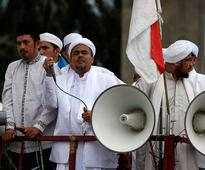 Indonesian police question Islamist leader as authorities warn over extremism