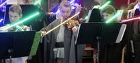 Very good kids play 'Star Wars' music using lightsaber violins