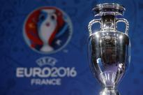 France to deploy 60,000 police for Euro 2016 The trophy of the Euro 2016 soccer tournament is displayed during a news con...