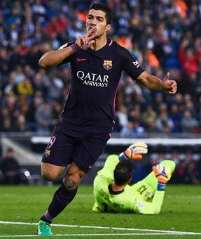 La Liga: Suarez double keeps Barca top, Marcelo rescues Real