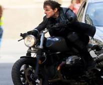 Tom Cruise rides a BMW R Nine T in MI6