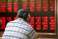 In China, stocks-for-loans under stress as markets slide