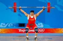 Cao Lei competes in the women's 75kg weightlifting event at the Beijing University of Aeronautics & Astronautics Gymnasium on Day 7 of the Beijing 2008 Olympics on Aug. 15, 2008 in Beijing, China.