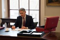 UK faces tougher Brexit challenge after better 2017