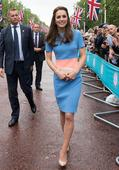 Kate Middleton recycles red coat and wedding day earrings for Garter service