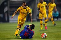 Chilean footballers vote to strike, matches ca... Universidad de Chile's player Matias Rodriguez, battles for the ball wit...