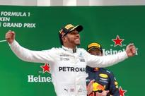 Hamilton coasts to fifth title at Chinese Grand Prix