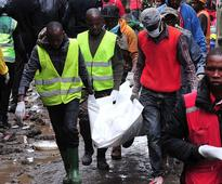 Kenya: 45 people rescued from collapsed buildi... Kenyan rescue workers carry a body after a building collapsed in Nairobi on ...