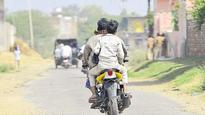Two-wheelers without number plates is a common sight in Mewat