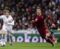 Dzeko must beg for Roma shirt - coach