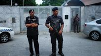 Malaysia: Police say bomb plot on top officers foiled, 14 held