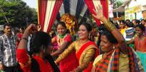 Women dancing in joy during Sindoor Khela
