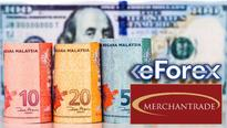 Ringgit dips against USD and SGD