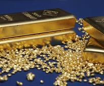 Gold edges up from five-week lows as equities fall