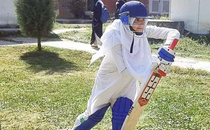 Kashmir's women cricketers pitch for equality -- in burqas and hijabs