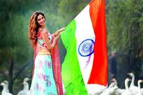 Miss Grand International Second Runner-up 2015 Vartika Singh unfurls the tricolour in Lucknow