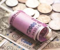 Rupee firms up by 23 paise to 64.09 against US dollar