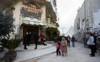 The Walled Off Hotel: Banksy opens dystopian tourist attraction in Bethlehem