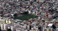 Rio de Janeiro police search slums for suspects in gang-rape case