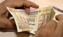 Rupee up 4 paise at 66.61