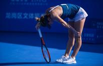 Halep cites knee pain as she crashes to shock defeat
