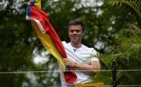 Venezuelan opposition leader Leopoldo Lopez salutes supporters after being sent from prison to house arrest