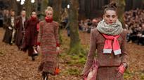 Karl Lagerfeld's models walk through wintry woods for Chanel Fall-Winter collection