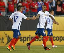 Chile scrape Copa win after penalty shocker Arturo Vidal #8 of Chile celebrates the first of two goals with Gary Medel #...