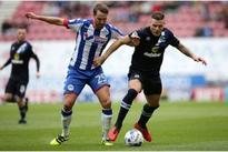 Opposition view: former Manchester United midfielder could be out for the season for Wigan Athletic