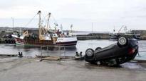 Sinking car rescue trio honoured