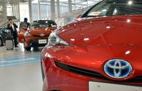 Toyota says net profit jumps to $16 bln, raises FY forecast
