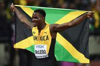 McLeod wins first gold for Jamaica, Merritt's dream dashed