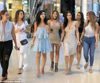 PICTURE EXCLUSIVE: Kim Kardashian is a dream in silky cleavage-baring cream dress during Vegas shopping spree with gal pals