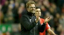 Liverpool plug defensive problems by signing Steven Caulker, but lose a star striker due to injury