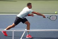 Raonic suffers shock defeat to Harrison at U.S. Open