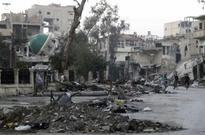 Syria: Assad's government forces recapture Deir ez-Zor hospital from Isis militants