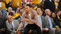 Steph Curry is one cheerful cheerleader on bench during Warriors' win
