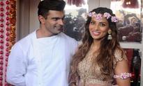 The bride wore pink: Bipasha Basu is radiant at 'mehendi' as groom-to-be Karan Singh Grover looks on