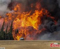 Canadian wildfire reaches oilsands camps, forcing more evacuation
