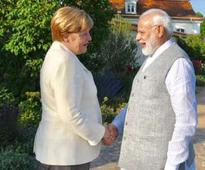 Modi meets Merkel at country retreat in Germany