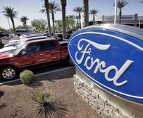 Ford posts record first-quarter profit; Priceline CEO resigns over conduct