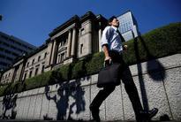 BOJ keeps policy steady as Fed sticks to rate-hike path
