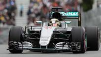 Hamilton takes pole for Canadian Grand Prix, followed by Rosberg and Vettel