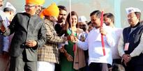 Arvind Kejriwal with party members during the Public meeting