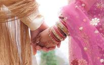 Two of marriage bureau held for cheating