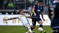 Football: Gladbach stay in hunt for Champions League berth