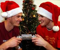 Andy Murray and brother Jamie pose in Santa hats and a cracker in festive photo